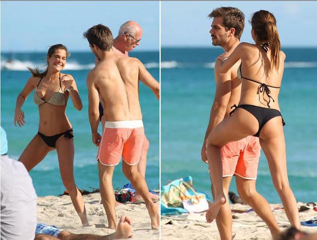 Jugando en la playa con su novio